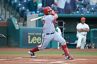 Israel Pineda (20) of the Hagerstown Suns follows through on his swing against the Greensboro Grasshoppers at First National Bank Field on April 6, 2019 in Greensboro, North Carolina. The Suns defeated the Grasshoppers 6-5. (Brian Westerholt/Four Seam Images)