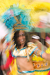 Motion blur of a woman dancing in the street parade for the  ZomerCarnaval (Summer Carnival) in Rotterdam, the Netherlands. The street parade is the colorful high point of the Rotterdam carnival. It is a tropical themed parade with over 2000 participants and travels 6km through the center of Rotterdam.