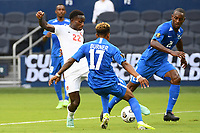 KANSASCITY, KS - JULY 11: Richie Laryea #22 of Canada with the ball during a game between Canada and Martinique at Children's Mercy Park on July 11, 2021 in KansasCity, Kansas.