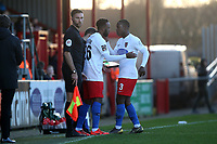 Myles Weston of Dagenham replaces Liam Gordon during Dagenham & Redbridge vs Stockport County, Vanarama National League Football at the Chigwell Construction Stadium on 8th February 2020