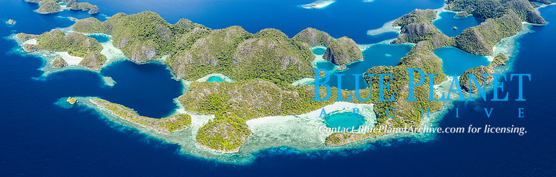 aerial view of a remote set of islands, surrounded by beautiful coral reefs, Raja Ampat Islands, West Papua, Indonesia, Pacific Ocean