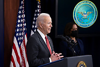 US President Joe Biden (L) delivers remarks to Department of Defense personnel as US Vice President Kamala Harris (R) looks on, at the Pentagon in Arlington, Virginia, USA, 10 February 2021.<br /> CAP/MPI/RS<br /> ©RS/MPI/Capital Pictures