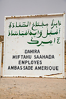 Senegal, Touba. Wolof, written in both Arabic and Latin script.  The sign indicates that a house is owned by the Senegalese employees of the American Embassy (in Dakar).  It is used as a guest house when employees make a religious pilgrimage to Touba.