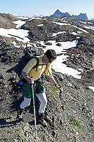 Man hiking on mountain ridge, Tomyhoi Peak, Yellow Aster Butte region, Whatcom County, North Cascades, Washington