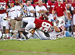 Oklahoma Sooners wide receiver Ryan Broyles (85) and Ball State Cardinals safety Sean Baker (25) in action during the game between the Ball State Cardinals  and the Oklahoma Sooners at the Oklahoma Memorial Stadium in Norman, Oklahoma. OU defeats Ball State 62 to 6.