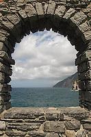 """- Portovenere (La Spezia), the coast towards the """"Cinque Terre"""" seen from an arc of the castle..- Portovenere (La Spezia), la costa verso le Cinque Terre vista da un arco del castello"""