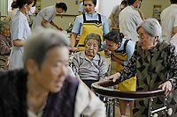 "Japan has too many elderly and not enough young people to staff all the nursing homes and care units in hospitals, so they have a program that brings in thousands of Philipino and Indonesian workers just for that purpose.  The two women in these photographs helping the elderly at the outpatient care unit are:.SITUMORANG (Last Name), Elvina (Indonesian) : .GOLLAYAN (Last Name), Maria Donnabel Pascua (Filipino) ..This is the hospital that has the robotic legs and the immigrant workers are being brought in for the same reason the robotics people are working on solutions for lonely elderly.  All of these robotics folks developing robots for elderly talk about studies showing that more and more elderly are isolated and have no one to relate to... In 2009 it was 19 percent of the elderly population of Japan.  They have a word for it:  ""Kodokushi"" or ""lonely death.""."