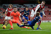17th December 2020, Emirates Stadium, London, England;  Arsenals Rob Holding  and goalkeeper Bernd Leno try to stop the shot from Southamptons Moussa Djenepo during the English Premier League match between Arsenal and Southampton