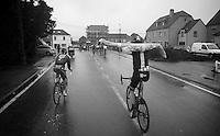 Bradley Wiggins (GBR) putting on his distinctive rain jacket<br /> <br /> Eneco Tour 2013<br /> stage 7: Tienen - Geraardsbergen<br /> 208km