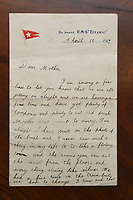 BNPS.co.uk (01202 558833)<br /> Pic: ZacharyCulpin/BNPS<br /> <br /> Pictured: A remarkable letter by a tragic hero of the Titanic disaster who was mesmerised by the luxury liner sold for £15,000. Henry Cotterill wrote the four page letter home to his mother while on board the ill-fated ship. <br />  <br /> Relics salvaged from the sunken ship that rescued the Titanic survivors have sold at auction for £135,000.<br /> <br /> The rare items included the engine room order telegraph the captain of the Carpathia used after he received the SOS from Titanic.<br /> <br /> He moved the handle to 'Full Steam Ahead', instructing staff in the engine room to rapidly increase speed