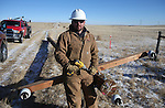 High West Energy apprentice lineman Jesse Robbins pauses while preparing a power pole for installation at a site south of Carpenter earlier this week. Robbins said the extreme wind is what is special about Laramie County. Robbins and his wife Liberty recently had their first child, Sadie, on December 6th. Michael Smith/staff