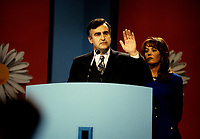 """Montreal (Qc) CANADA - File Photo - Oct 30 1995 -<br /> <br /> Lucien Bouchard, Leader Bloc Quebecois and wife  adress the crowd present at the Montreal Convention Centre on the Referendum night, Oct 30 1995.<br /> <br /> The 1995 Quebec referendum was the second referendum to ask voters in the Canadian province of Quebec whether Quebec should secede from Canada and become an independent state, through the question:<br /> <br />     * Do you agree that QuÈbec should become sovereign after having made a formal offer to Canada for a new economic and political partnership within the scope of the bill respecting the future of QuÈbec and of the agreement signed on June 12, 1995?.<br /> <br /> The 1995 referendum differed from the first referendum on Quebec's sovereignty in that the 1980 question proposed to negotiate """"sovereignty-association"""" with the Canadian government, while the 1995 question proposed """"sovereignty"""", along with an optional partnership offer to the rest of Canada.<br /> <br /> The referendum took place in Quebec on October 30, 1995, and the motion to decide whether Quebec should secede from Canada was defeated by a very narrow margin of: 50.58% """"No"""" to 49.42% """"Yes""""."""