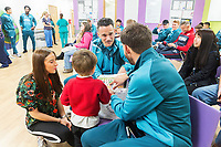 THIS IMAGE CANNOT BE USED AS IT CONTAINS MEMBERS OF THE PUBLIC IN THE BACKGROUND WHO MAY NOT HAVE CONSENTED<br /> Thursday 21 December 2017<br /> Pictured: Roque Mesa of Swansea City, Angel Rangel<br /> Re: Swansea City Childrens Ward Visit, Morriston Hospital, Swansea, Wales, UK