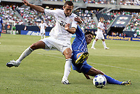 Davy Arnaud (22) and Melvin Valladares (18) battle for the ball.  The US Men's National Team defeated Honduras 2-0 in the semifinals of the Gold Cup at Soldier Field in Chicago, IL on July 23, 2009.