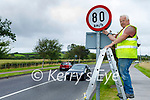 Gerard Griffin of the Kerry County Council installing the new speed limit sign of 80km, which has been upgraded from 60km on the Bracker Regan road in Tralee on Tuesday