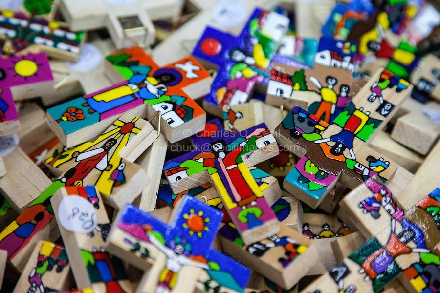 Antigua, Guatemala.  Small Hand-painted Souvenir Crosses, Nim Po't Handicrafts Outlet.
