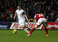 Tuesday, 28 January 2014<br /> Pictured L-R: Ben Davies of Swansea against Scott Parker of Fulham. <br /> Re: Barclay's Premier League, Swansea City FC v Fulham at the Liberty Stadium, south Wales.