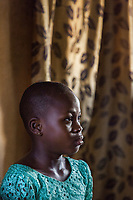 Nigeria. Enugu State. Enugu. Town center. Portrait of a young Igbo girl at home. Enugu is the capital of Enugu State, located in southeastern Nigeria. 5.07.19 © 2019 Didier Ruef