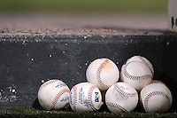 International League game used baseballs sit on the dugout step during a game between the Rochester Red Wings and Durham Bulls on May 17, 2013 at Frontier Field in Rochester, New York.  Rochester defeated Durham 11-6.  (Mike Janes/Four Seam Images)