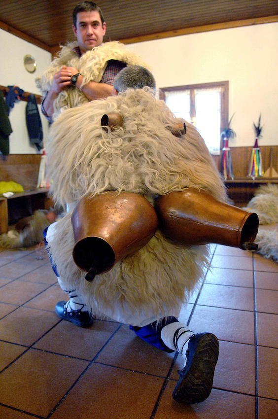 ITUREN, NAVARRE - JANUARY 30: Some men dresses 'Zanpantzar' clothes, sheep furs and big cowbells to their back, before march through Ituren village on January 30, 2006. Zanpantzar´s celebrate an ancient traditional carnival marching through Ituren village and sounding their cowbells to wake up the earth for a good new farmer year and keep far away bad spirits. Photo by Ander Gillenea