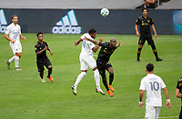 LOS ANGELES, CA - OCTOBER 25: Julian Araujo #22 of the Los Angeles Galaxy and Bradley Wright-Phillips #66 of LAFC get after a ball during a game between Los Angeles Galaxy and Los Angeles FC at Banc of California Stadium on October 25, 2020 in Los Angeles, California.