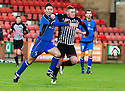 Stranraer's Frank McKeown and Pars' Ryan Thomson challenge for the ball.