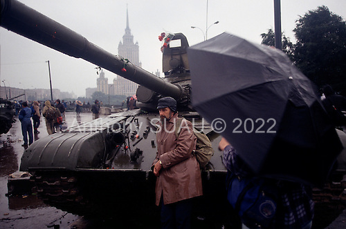 Moscow, Soviet Union<br /> August 21, 1991<br /> <br /> Pro-Yeltsin tanks become more decorative than threatening on the third day of the Soviet coup d'état attempt (August 19-21, 1991), also known as the August Putsch or August Coup. A small group of the Soviet government officials briefly deposed president Mikhail Gorbachev in an attempted to take control of the country. The coup leaders were hard-line members of the Communist Party (CPSU) who felt that Gorbachev's reforms had gone too far in dispersing the central government's power to the republics - better known as perestroika. The coup collapsed in three days, and Gorbachev returned to power, crushing the Soviet leader's hopes that the union could be held together in a decentralized form.
