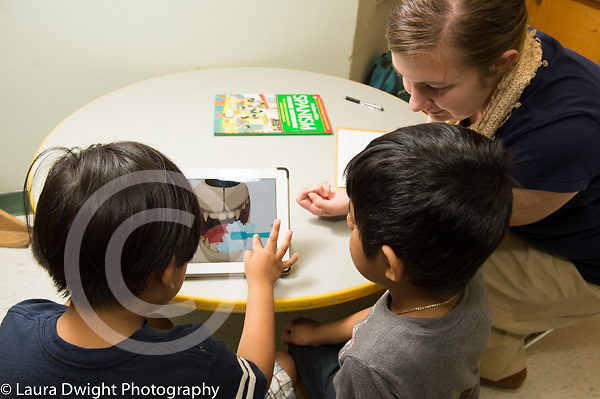 Education preschool 3-4 year olds, speech therapist at work wutg twi boys using iPad tablet computer