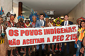"""Indians and sympathetic congressmen hold a banner saying """"The Ondigenous Peoples reject PEC 215"""" in Congress during an audience with the Xicrin, Kayapo and Pataxo tribes. Brasilia, Brazil, 10th November 2015. Photo © Sue Cunningham, pictures@scphotographic.com"""