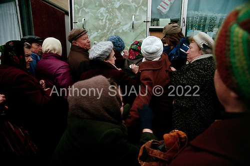 """Moscow, Russia.October 22, 1992..People fight to purchase cigarettes, for resale, at a kiosk near Kievski train station. The early days of the """"rezbourka"""", a business sorting out that left many dead throughout Russia in the 1990's...In December 1991, food shortages in central Russia had prompted food rationing in the Moscow area for the first time since World War II. Amid steady collapse, Soviet President Gorbachev and his government continued to oppose rapid market reforms like Yavlinsky's """"500 Days"""" program. To break Gorbachev's opposition, Yeltsin decided to disband the USSR in accordance with the Treaty of the Union of 1922 and thereby remove Gorbachev and the Soviet government from power. The step was also enthusiastically supported by the governments of Ukraine and Belarus, which were parties of the Treaty of 1922 along with Russia...On December 21, 1991, representatives of all member republics except Georgia signed the Alma-Ata Protocol, in which they confirmed the dissolution of the Union. That same day, all former-Soviet republics agreed to join the CIS, with the exception of the three Baltic States......"""