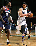 Reno Bighorns' Trent Lockett drives past Bakersfield Jam's Damion James during a D-League basketball game in Reno, Nev., on Tuesday, Jan. 14, 2014. The Bighorns won 93-85.<br /> Photo by Cathleen Allison