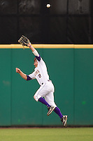 LSU Tigers outfielder Mason Katz #8 leaps for a fly ball during the continuation of their suspended NCAA Super Regional baseball game against Stony Brook on June 9, 2012 at Alex Box Stadium in Baton Rouge, Louisiana. LSU defeated Stony Brook 5-4 in 12 innings. (Andrew Woolley/Four Seam Images)