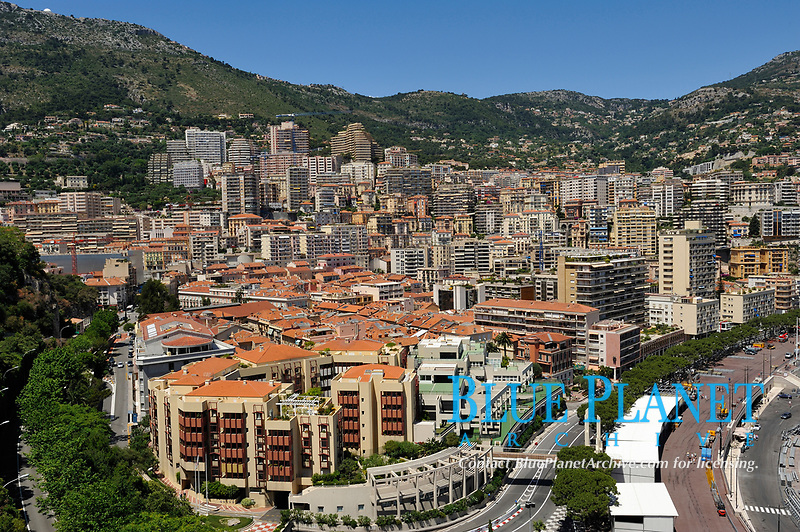"""View on the Principality of Monaco, Mediterranean Sea. The photo shows La Condamine ward. The Monte Carlo ward is the principal residential and resort area with the casino. The picture has been taken from the place in front of The Palace in Monaco-Ville ward the old city which is on a rocky promontory known as Rock of Monaco (in French """"Le Rocher""""). Monaco is the second smallest country in the world after Vatican City."""