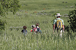 Family on a nature hike in the Rocky Mountains, Boulder, Colorado. .  John leads private photo tours in Boulder and throughout Colorado. Year-round.