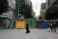 A barricade on one of the roads leading to Tahrir Square. Throughout Friday, 4 February, anti government protesters protected their positions from pro Mubarak supporters around Tahrir square, the scene of heavy clashes between pro and anti government protesters. Continued anti-government protests take place in Cairo calling for President Mubarak to stand down. After dissolving the government and allowing for talks with opposition parties Mubarak still refuses to step down from power...