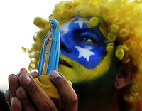 Brazil supporter prays during a live broadcast of the soccer World Cup match between Brazil and Mexico<br />  on Copacabana beach, Rio de Janeiro, Brazil, June 17, 2014