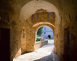 Tuscany, Italy<br /> Morning sun floods an arched passage in the fortress walls of Fortezza Orsini in the village of Sorano, a hill town in southern tuscany