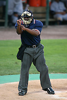 April 11, 2009:  Home plate umpire Kelvin Bultron during a game at Joker Marchant Stadium in Lakeland, FL.  Photo by:  Mike Janes/Four Seam Images
