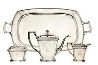 BNPS.co.uk (01202 558833)<br /> Pic: SheldonCarpenter/Witherell'sInc/BNPS<br /> <br /> Pictured: Al Capone's pantheon sterling silver tea service sold for £11,554 ($15,730).<br /> <br /> An incredible treasure trove of Al Capone heirlooms have sold at auction for a whopping £2.3m. ($3.1m)<br /> <br /> The star lot was the notorious American gangster's favourite gun - a 1911 Colt semi-automatic pistol, which was expected to fetch £110,000 but sold for an incredible £764,000. ($1.04m)<br /> <br /> The remarkable collection, sold by his granddaughters, included personalised jewellery, photographs and furniture and a letter written to his only child Sonny from Alcatraz Prison, which showed a tender side to the ruthless crime boss.