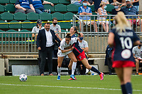 CARY, NC - APRIL 10: Carson Pickett #4 of the NC Courage is fouled by Ashley Hatch #33 of the Washington Spirit during a game between Washington Spirit and North Carolina Courage at Sahlen's Stadium at WakeMed Soccer Park on April 10, 2021 in Cary, North Carolina.