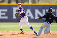 Tony Fortier-Bensen (8) of the High Point Panthers attempts to turn a double play as Michael Paez (1) of the Coastal Carolina Chanticleers slides into second base at Willard Stadium on March 15, 2014 in High Point, North Carolina.  The Chanticleers defeated the Panthers 1-0 in the first game of a double-header.  (Brian Westerholt/Four Seam Images)