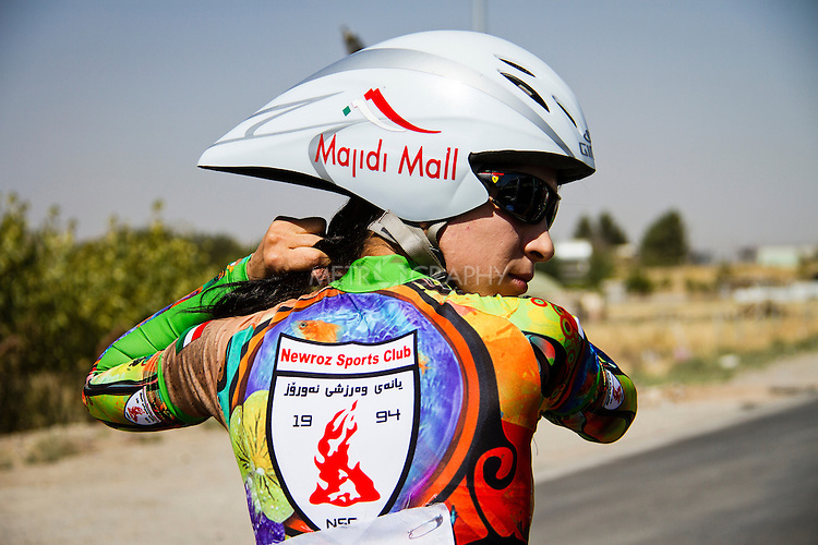 SULAIMANIYAH, IRAQ: Professional cyclist Nyan Yassin prepares for a race by plaiting her hair.<br /> <br /> Nyan Yassin, 24, is a professional competitive cyclist in Sulaimaniyah in the semi-autonomous region of Iraqi Kurdistan.  She is the captain of an all-female club called Newroz Club, which is the only cycling club for women in Sulaimaniyah, although there are other clubs around Iraq.  She trains and competes on roads that are badly surfaced and busy with traffic.<br /> <br /> Nyan was the first woman to start cycling in Sulaimaniyah.  She was always competitive and after trying her hand at different sports she settled on cycling.  She is now the top female cyclist in Iraq.  Her nickname is MigMig after the noise made by the cartoon character Roadrunner.<br /> <br /> Despite being clearly talented at her sport Nyan knows that in a couple of years she will have to get married and then abandon it as, in the traditional society that Kurdistan is, being a wife and a competitive sportswoman at the same time is not an option.<br /> <br /> Photo by Gona Hassan/Metrography