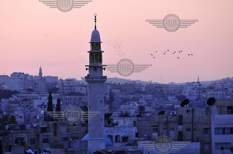 A minaret in Amman at sunset..