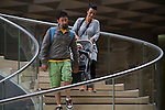 Parents and baby stroller descending the stairs at the Louvre Museum, Paris, France, .  John offers private photo tours in Denver, Boulder and throughout Colorado, USA.  Year-round. .  John offers private photo tours in Denver, Boulder and throughout Colorado. Year-round.