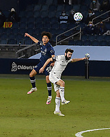 KANSAS CITY, KS - OCTOBER 24: #28 Cameron Duke of Sporting Kansas City and #19 Jack Price of the Colorado Rapids jump up to head the ball during a game between Colorado Rapids and Sporting Kansas City at Children's Mercy Park on October 24, 2020 in Kansas City, Kansas.