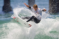 Aussie Ben Dunn turns off the top on an inside section during round of 96 of the 2010 US Open of Surfing in Huntington Beach, California on August 4, 2010.