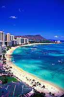 Diamond Head Crater and inviting sands of legendary Waikiki Beach.