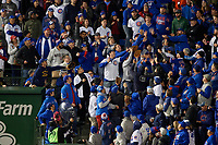 Chicago Cubs fans catch a home run ball from Jose Ramirez (not shown) in the second inning during Game 5 of the Major League Baseball World Series against the Cleveland Indians on October 30, 2016 at Wrigley Field in Chicago, Illinois.  (Mike Janes/Four Seam Images)