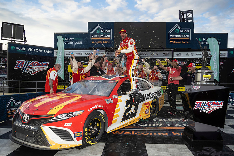 #23: Bubba Wallace, 23XI Racing, Toyota Camry McDonald's celebrates in regular victory lane with his crew after the rain stopped