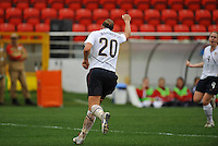 Abby Wambach celebrates her first of two goals.  The USA defeated Norway 2-1 at Olhao Stadium on February 26, 2010 at the Algarve Cup.